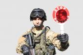 Special Forces soldier, gives a command to stop a vehicle checkpoint, isolated on white — Stok fotoğraf