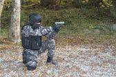 Special anti-terrorist squad, coached at the shooting range, kneeling shooter, police swat — Stock Photo