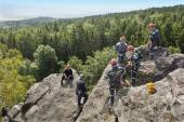Stary Plzenec, Czech Republic, June 3, 2014: training rescue team. Rescue in rocky terrain near the castle RADYNE. — Stock Photo