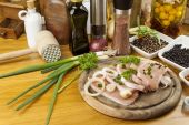Home food preparation in the kitchen, roast pork on grill, Raw pork on cutting board and vegetables — Stock Photo