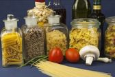 Various types of pasta on the table, homemade food preparation — Stock Photo