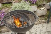Barbecue grill, charcoal and Flames of Fire, igniting the grill — Stock Photo
