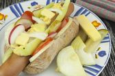 Domestic hot-dog with vegetables, fast food preparation at home. — Stock Photo