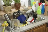 Dirty dishes in the sink after family celebrations. Home cleaning the kitchen. — Stock Photo