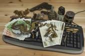 Internet illegal arms trade. Merchant arrest illegal ammunition. Internet crime. Current euro banknotes and Czech koruna. — Stock Photo