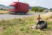 Memorial site a real tragic traffic accident on a country road. Instead of the death of motorcyclists. Dangerous deadly speed. The danger of accidents. Speeding on the roads. Monument near the road. — Stock Photo