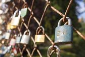 Lock of love. Desire of eternal love, locked lock on the bridge. Symbol of mutual love. Wishes for Valentine's Day, instead of text. Old lock hung on a wire fence. — Stock Photo