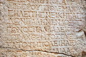 Old text on ancient wall stone — Stock Photo
