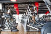 People exercizing in row of treadmills — Stock Photo