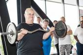 Female contestant performing the strict curl — Stock Photo