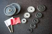 Barbell weights plates with arbiter flags — Stock Photo