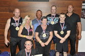 Proud male and female contestants showing their medals and troph — Stock Photo