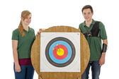 Boy and girl standing besides archery target — Stock Photo
