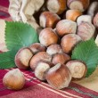 Постер, плакат: Hazelnuts on table