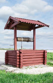 Wooden red well — Stock Photo
