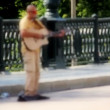 Busker plays the guitar for passers — Stock Video #55455193