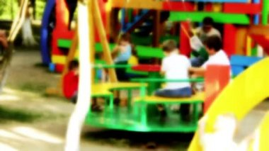Children ride on amusement — Vídeo Stock