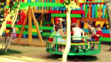 Children ride on amusement — Wideo stockowe
