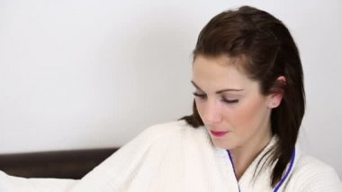 Smiling woman in bathrobe — Stock Video