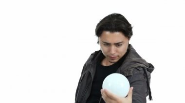 Young magician with crystal ball — 图库视频影像