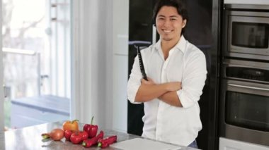 Home chef in a modern kitchen wearing a white shirt — Stock Video