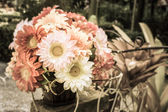 Vintage artificial flower in the garden — Stockfoto