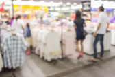 Blurred people walking in the shopping center — Stock Photo