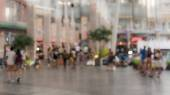 Blurred people walking in the shopping mall — ストック写真