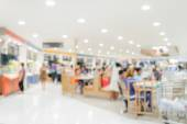 Blurred people in food court — Stock Photo