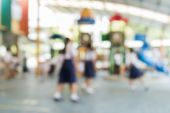 Blurred schoolchild are playing in the playground — Stock Photo