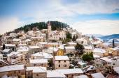 Small Mediterranean town on the slopes of hill with a church on top — Stock Photo