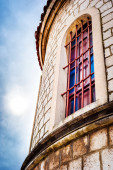Detail of church architecture in Dalmatia with cloudy sky in back — Stock Photo