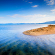 Lone small sandy island in the middle of blue sea — Stock Photo #70204611