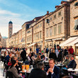 DUBROVNIK, CROATIA - APRIL 10: Tourists enjoy the terraces of restaurants in the old town of Dubrovnik on the main street Stradun on April 10, 2015. — Stock Photo #71725829