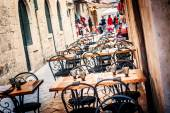 DUBROVNIK, CROATIA - APRIL 10: Restaurant terrace in the old town of Dubrovnik, in the narrow streets, are ready for tourists from all over the world on April 10, 2015. — Stock Photo
