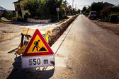 Road works. The sign on the road and dug up roads — Stock Photo