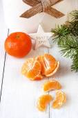 Christmas composition with fruits and pine brunches — Stock Photo