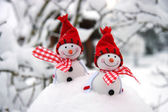 Two smiling snowmen friends in the snow — Stock Photo