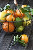 Orange mandarines heap in  wicker basket — Stock Photo