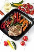 Meat  with vegetables on pan — Stock Photo