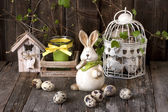 Vintage easter decoration with eggs and rabbit — Stock Photo