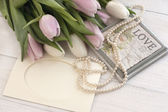 Holiday still life with tulips and pearls — Stockfoto