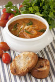 Sauerkraut soup in ceramic bowl on wooden table — Stock Photo