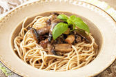 Pasta with mushrooms and sauce — Stock Photo