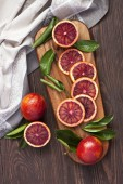 Fresh blood oranges on wooden background — Stock Photo