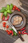Meat with vegetables on wooden table — Stock Photo