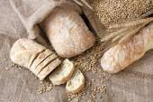 Ciabatta  and baquette with ears on the burlap — Stock Photo