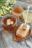 Honey, camomile and  tea on wooden  background — Stockfoto