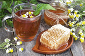 Honey, camomile and  tea on wooden  background — Foto Stock