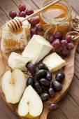 Composition with grape, cheese and honey — Stock Photo